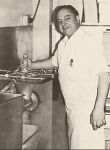 Sam Carlino, Sr. making sausage, 1976